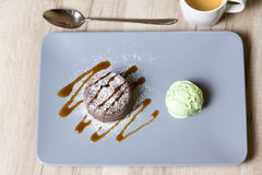 Chocolate fondant lava cake with caramel topping and ice cream. Selective focus stock image
