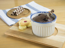 Chocolate fondant lava cake. With cookies and banana in ceramic cup on wooden tray stock images