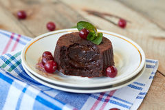 Chocolate fondant. Lava cake with cranberry and mint stock photos