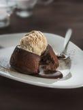 Chocolate fondant lava cake. Hot chocolate fondant lava cake pudding with ice cream royalty free stock photos