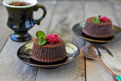Chocolate fondant. Lava cake with raspberries and mint Royalty Free Stock Images