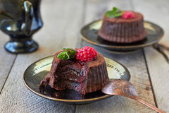 Chocolate fondant. Lava cake with raspberries and mint royalty free stock photo