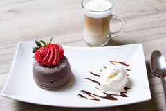 Chocolate fondant lava cake with strawberries and ice cream. Selective focus royalty free stock photo
