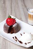 Chocolate fondant lava cake with strawberries. And ice cream. Selective focus royalty free stock images