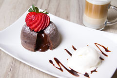 Chocolate fondant lava cake with strawberries and ice cream. Selective focus stock photos