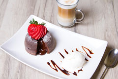 Chocolate fondant lava cake with strawberries and ice cream. Selective focus stock images