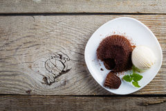 Chocolate fondant - lava cake with vanilla ice cream. Copy space Royalty Free Stock Image