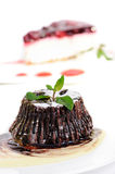 Chocolate fondant with peppermint leaves Stock Photo