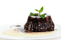 Chocolate fondant with peppermint leaves Stock Photos