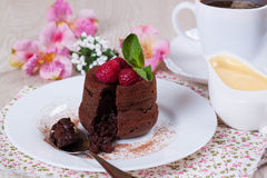 Chocolate fondant with raspberries. On the plate Stock Image