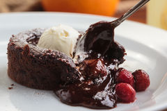 Chocolate fondant with strawberry and ice cream Stock Photography