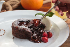 Chocolate fondant with strawberry and ice cream Royalty Free Stock Image