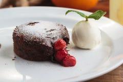 Chocolate fondant with strawberry and ice cream Stock Image