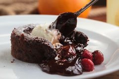 Chocolate fondant with strawberry and ice cream Royalty Free Stock Photos