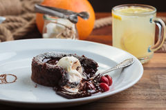 Chocolate fondant with strawberry and ice cream Stock Photo