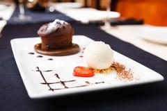 Chocolate fondant. With vanilla ice cream and raspberry sauce stock images