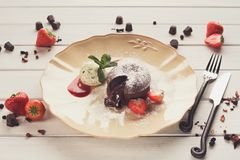 Chocolate fondant with vanilla ice cream and strawberry Royalty Free Stock Images