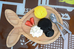 Chocolate fondant with vanilla ice cream. On wooden plate. horizontal view from above Royalty Free Stock Photography