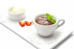 Chocolate fondant in a white cup royalty free stock image