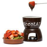 Chocolate fondue. Fruits with chocolate fondue, isolated Royalty Free Stock Photo