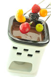 Chocolate fondue. With fruits on the white Stock Images