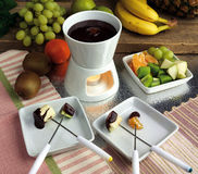 Chocolate fondue. With different sorts of fruit Stock Image