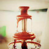 Chocolate fondue fountain Stock Images