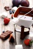 Chocolate fondue Stock Images