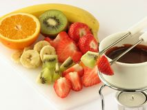 Chocolate fondue with fruit Stock Photo