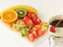 Chocolate fondue with fruit Royalty Free Stock Photos