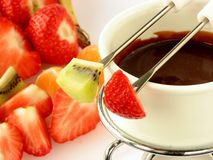 Chocolate fondue with fruit Royalty Free Stock Image