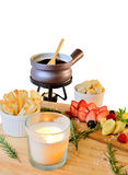 Chocolate fondue with fruit and bread Royalty Free Stock Image