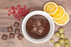 Chocolate fondue with fruits. Overview Stock Photos