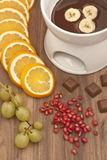 Chocolate fondue with fruits. On desk Royalty Free Stock Image