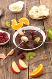 Chocolate fondue with fruits stock photography