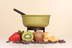 Chocolate fondue kit and fruits Stock Photos