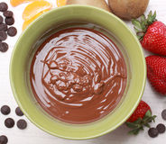 Chocolate fondue kit and fruits Royalty Free Stock Image