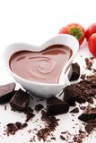 Chocolate fondue melted with fresh strawberries and dark chocola. Chocolate fondue melted with fresh strawberries and milk chocolate pieces Stock Photo