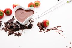 Chocolate fondue melted with fresh strawberries and dark chocola. Chocolate fondue melted with fresh strawberries and milk chocolate pieces Stock Images