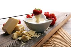 Chocolate fondue melted with fresh strawberries and white chocol. Ate pieces Royalty Free Stock Photography