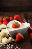 Chocolate fondue melted with fresh strawberries and white chocol. Ate pieces Stock Photography