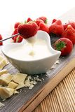 Chocolate fondue melted with fresh strawberries and white chocol. Ate pieces Stock Photo