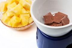 Chocolate fondue with pineapple pieces Royalty Free Stock Image