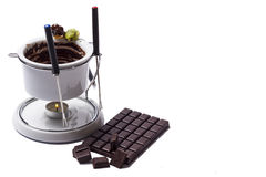 Chocolate fondue on white background Royalty Free Stock Photography
