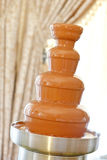 Chocolate fountain. Pouring chocolate fountain at wedding Royalty Free Stock Photo
