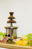 Chocolate fountain. With fresh fruit Stock Photography