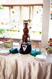 Chocolate fountain and fruit stock image