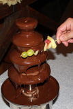 The chocolate fondue. With fruits stock photos