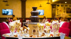 Chocolate fountain with fruits royalty free stock images