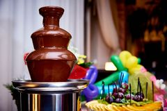 Chocolate fountain on the holiday table stock image